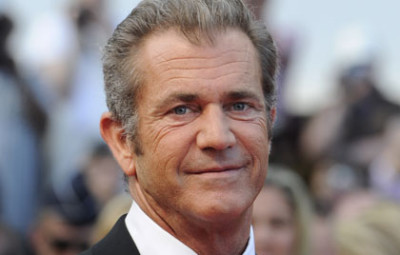 US actor Mel Gibson poses on the red car